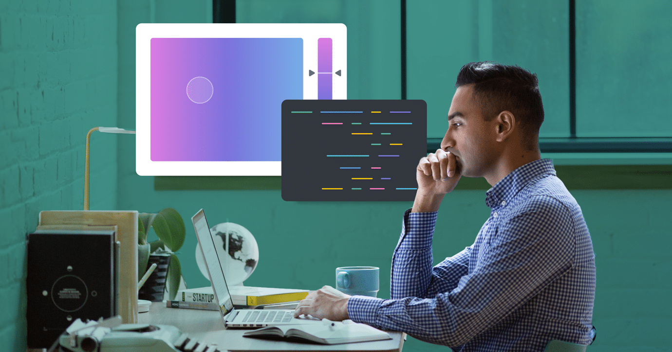 man sitting at desk as he codes background colors into his HTML email